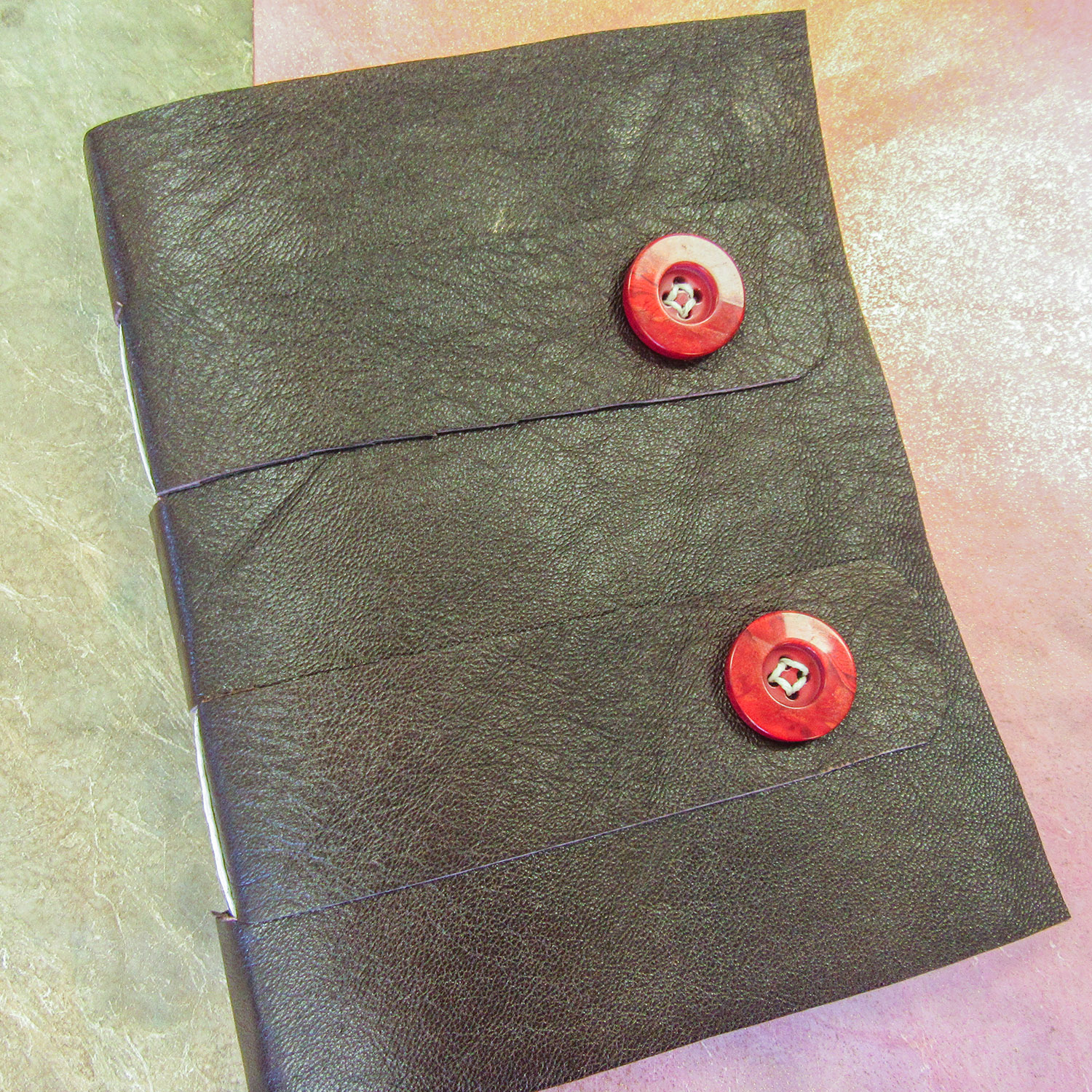 Lauren Campbell, crossed structure book binding