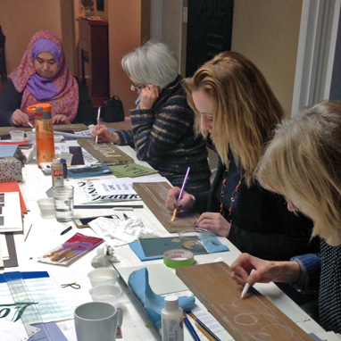 Sign painting class participants at work.